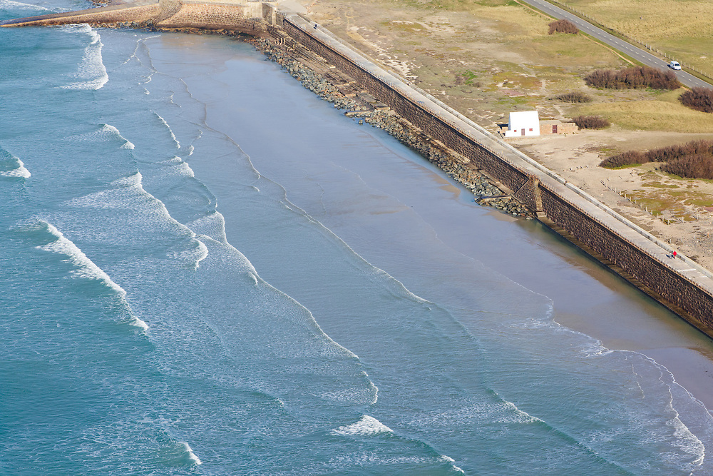 Aerial view of the National Trust property, the White House, at high tide along St Ouen's Bay in Jersey, Channel Islands