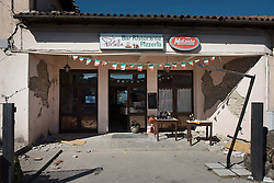 © London News Pictures. 25/08/2016. Amatrice, Italy. Earthquake damage is seen at a cafe in the town of Amatrice in central Italy where a 6.2-magnitude earthquake destroyed towns in the area. The death toll is currently at 247 with dozens of people still missing. Thousands of rescuers continue efforts to find survivors. Photo credit: Mario Sabatini/LNP
