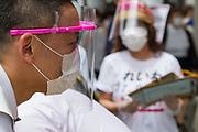 Taro Yamamoto,  a former actor and politician, wears a face-shield against COVID-19 infection as he campaigns  for election as the Tokyo Governor in Futaka Tamagawa, Tokyo, Japan. Tuesday June 23rd 2020. The incumbent  governor, Yuriko Koike (not pictured) is expected to be reelected when the election are held on Sunday July 5th 2020