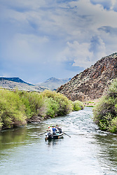 Fly-fishing on the Beaverhead River in Southwest Montana.  Drift boats are the most efficient to fish the freestone rivers of the Rocky Mountain West.