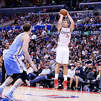 15 April 2014: Los Angeles Clippers forward Blake Griffin (32) takes a jump shot during the Los Angeles Clippers 117-105 victory over the Denver Nuggets at the Staples Center, Los Angeles, California, USA.