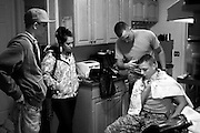 Corey Fernandes and Alanna Ojibway look on as Sean Fernandes gives his friend Chris Dunn a haircut in Wilder, Vt., before the two National Guard Soldiers muster at the Westminster Armory for a deployment to Afghanistan, Thursday, October 29, 2009. Best friends in school, Fernandes and Dunn joined the military at the same time and now serve in the same company. It has become tradition for the pair to give each other hair cuts at Fernandes' home before leaving for their monthly training drills.<br /> Valley News - James M. Patterson