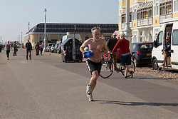 People on the seafront in Hove, near Brighton, East Sussex, as the UK continues in lockdown to help curb the spread of Coronavirus.