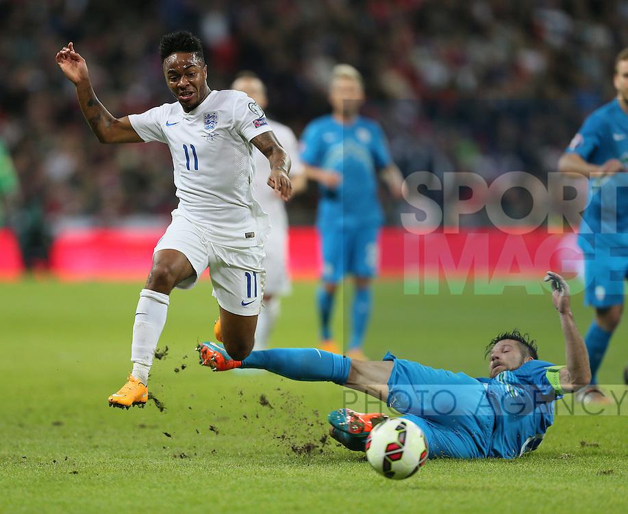 England's Raheem Sterling tussles with Slovenia's Bostjan Cesar<br /> <br /> - International European Qualifier - England vs Slovenia- Wembley Stadium - London - England - 15th November 2014  - Picture David Klein/Sportimage