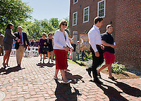 Allison Ambrose congratulates Peter Karagianis as he and his family jane, Nicole, Christian and Evan take their first walk on Peter S. Karagianis Way following the dedication ceremony in his honor at the Belknap Mill Thursday morning.  (Karen Bobotas/for the Laconia Daily Sun)