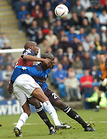 SPORTSBEAT 01494 783165<br /> PICTURE ADY KERRY .<br /> GILLINGHAM VS IPSWICH TOWN<br /> GILLINGHAM'S  MAMADY SIDIBE CHALLENGES WITH IPSWICH'S DRISSA DIALLO, 17TH APRIL 2004.