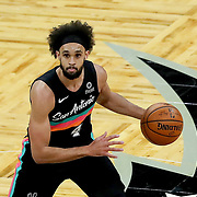 ORLANDO, FL - APRIL 12: Derrick White #4 of the San Antonio Spurs controls the ball against the Orlando Magic at Amway Center on April 12, 2021 in Orlando, Florida. NOTE TO USER: User expressly acknowledges and agrees that, by downloading and or using this photograph, User is consenting to the terms and conditions of the Getty Images License Agreement. (Photo by Alex Menendez/Getty Images)*** Local Caption *** Derrick White