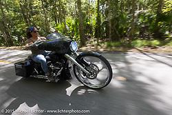 "Crystal Oxendine rides her 30"" front wheel custom Harley-Davidson Street Glide through Tamoka State Park during Daytona Beach Bike Week  2015. FL, USA. Friday, March 13, 2015.  Photography ©2015 Michael Lichter."