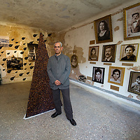 VENICE, ITALY - JUNE 02:  Artist Ali Assaf posesin front of one of his work at the Iraq pavillion on June 2, 2011 in Venice, Italy. This year's Biennale is the 54th edition and will run from June 4th until 27 November.