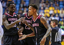 Dec 14, 2019; Morgantown, WV, USA; Nicholls State Colonels forward Jaylen Fornes (1) celebrates with Nicholls State Colonels forward Elvis Harvey Jr. (23) and Nicholls State Colonels forward Warith Alatishe (25) during the first half against the West Virginia Mountaineers at WVU Coliseum. Mandatory Credit: Ben Queen-USA TODAY Sports