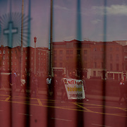 DUBLIN, IRELAND - MAY 28, 2016: The reflection of people taking part in a protest march against the ongoing housing and homeless crisis in Ireland and demanding the government to declare a national housing emergency, can be seen on the window of a local social club in central Dublin. About one thousand people from several unions and representatives from various housing pressure spots, including the residents of an apartment block facing eviction in Tyrellstown after their rented accommodation was bought by a vulture fund, answered the call for protest by the National Homeless and Housing Coalition, which is also calling for increases in rent supplement rates, a halt to all evictions, rent certainty and increased protections for tenants. CREDIT: Paulo Nunes dos Santos for The New York Times