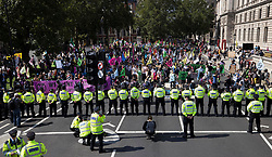 © Licensed to London News Pictures. 01/09/2020. London, UK. A line of police stop Extinction Rebellion (XR) environmental campaign protesters reaching Parliament. XR plan to peacefully disrupt the UK Parliament with actions planned over two weeks, until MP's back the Climate and Ecological Emergency Bill and prepare for crisis with a National Citizens' Assembly. Photo credit: Peter Macdiarmid/LNP