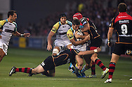 Andrew Bishop of the Ospreys © is tackled by Tyler Morgan of the Dragons. Guinness Pro12 rugby union, Newport Gwent Dragons v Ospreys at Rodney Parade in Newport, South Wales on Friday 12th Sept 2014<br /> pic by Andrew Orchard, Andrew Orchard sports photography.