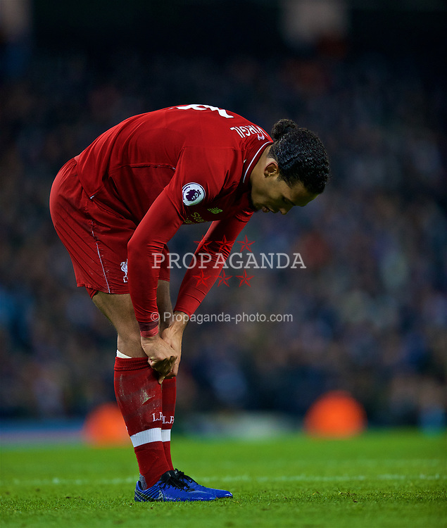 MANCHESTER, ENGLAND - Thursday, January 3, 2019: Liverpool's Virgil van Dijk pulls up his socks during the FA Premier League match between Manchester City FC and Liverpool FC at the Etihad Stadium. (Pic by David Rawcliffe/Propaganda)