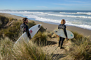 Local surfers Matt Parker and Ian Queiroz check the swell before a surf at Salmon Creek Beach, Sonoma Coast State Park, California