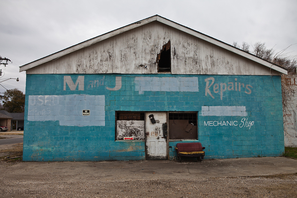 """Closed auto repair shop on the Scenic Highway<br />  located in the stretch between Baton Rouge and New Orleans along the Mississippi River has a large concentration of chemical and oil companies and was formerly referred to as the """"petrochemical corridor"""" but now is know as """"cancer alley"""" after numerous cases of cancer occurring in the small rural communities on both sides of the river were reported."""