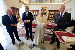 December 2, 2016 - Rome, Italy - U.S Secretary of State John Kerry and U.S. Ambassador to the Holy See Kenneth Hackett smile as they are presented gifts by Pope Francis following their meeting at the Vatican December 2, 2016 in Rome, Italy. (Credit Image: © Us State Department/Planet Pix via ZUMA Wire)
