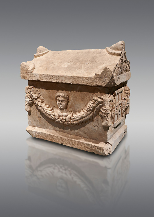 Roman relief decorated garland osthotek cremation container, 2nd century AD. An ostothec is used to preserve the ashes and bones of the dead bodies after their cremation, takes its form from a small sarcophagus. This ostothec is a miniature example of the garland sarcophagus. Adana Archaeology Museum, Turkey. Against a grey background .<br /> <br /> If you prefer to buy from our ALAMY STOCK LIBRARY page at https://www.alamy.com/portfolio/paul-williams-funkystock/greco-roman-sculptures.html . Type -    Adana     - into LOWER SEARCH WITHIN GALLERY box - Refine search by adding a subject, place, background colour, museum etc.<br /> <br /> Visit our ROMAN WORLD PHOTO COLLECTIONS for more photos to download or buy as wall art prints https://funkystock.photoshelter.com/gallery-collection/The-Romans-Art-Artefacts-Antiquities-Historic-Sites-Pictures-Images/C0000r2uLJJo9_s0