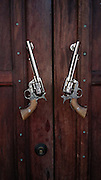 A pair of revolvers - or six shooters - used as door pulls in Eastern Washington State.