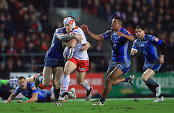 St Helens' Theo Fages breaks through Wakefield Trinity Wildcats' Reece Lyne (right) during the Betfred Super League match at the Totally Wicked Stadium, St Helens.