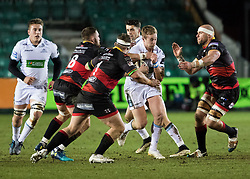 Glasgow Warriors' Brandon Thomson under pressure from  Dragons' Rynard Landman<br /> <br /> Photographer Simon King/Replay Images<br /> <br /> Guinness PRO14 Round 14 - Dragons v Glasgow Warriors - Friday 9th February 2018 - Rodney Parade - Newport<br /> <br /> World Copyright © Replay Images . All rights reserved. info@replayimages.co.uk - http://replayimages.co.uk