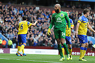 Everton keeper Tim Howard celebrates after he saves a 1st half penalty taken by Aston Villa's Christian Benteke.Barclays Premier League, Aston Villa v Everton at Villa Park in Aston, Birmingham on Saturday 26th Oct 2013. pic by Andrew Orchard, Andrew Orchard sports photography,