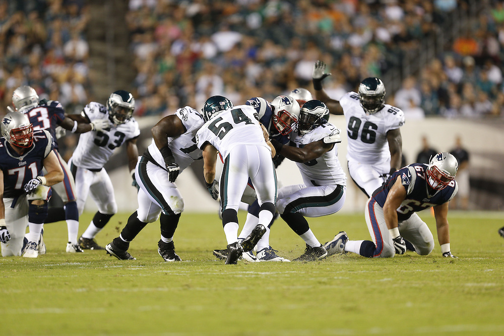 New England Patriots quarterback Tim Tebow #5 is sacked during the preseason NFL game between the Philadelphia Eagles and the New England Patriots on August 9th 2013 in Philadelphia. (Photo by Brian Garfinkel)