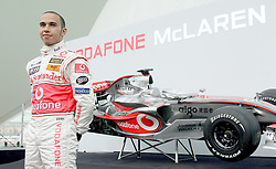 File photo dated 15-01-2007 of Vodafone McLaren Mercedes driver Lewis Hamilton of Great Britain poses with the new McLaren MP4-22 Formula One car during the launch in L'Hemisferic, Ciudad de las Artes y de las Ciencias, Valencia, Spain.