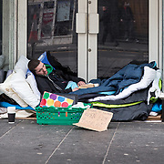 Homeless people sleeping on streets of Glasgow. A man lies sleeping on Argyle Street. <br /> <br /> Picture Robert Perry 16th March 2017<br /> <br /> Must credit photo to Robert Perry<br /> FEE PAYABLE FOR REPRO USE<br /> FEE PAYABLE FOR ALL INTERNET USE<br /> www.robertperry.co.uk<br /> NB -This image is not to be distributed without the prior consent of the copyright holder.<br /> in using this image you agree to abide by terms and conditions as stated in this caption.<br /> All monies payable to Robert Perry<br /> <br /> (PLEASE DO NOT REMOVE THIS CAPTION)<br /> This image is intended for Editorial use (e.g. news). Any commercial or promotional use requires additional clearance. <br /> Copyright 2014 All rights protected.<br /> first use only<br /> contact details<br /> Robert Perry     <br /> 07702 631 477<br /> robertperryphotos@gmail.com<br /> no internet usage without prior consent.         <br /> Robert Perry reserves the right to pursue unauthorised use of this image . If you violate my intellectual property you may be liable for  damages, loss of income, and profits you derive from the use of this image.