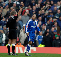 Photo: Daniel Hambury.<br />Arsenal v Cardiff City. The FA Cup. 07/01/2006.<br />Cardiff's Jeff Whitley (R) is booked by referee Martin Atkinson.