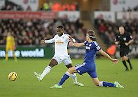 Swansea City's Nathan Dyer vies for possession with Chelsea's Filipe Luis<br /> <br /> Photographer /Ashley CrowdenCameraSport<br /> <br /> Football - Barclays Premiership - Swansea City v Chelsea - Saturday 17th January 2015 - Liberty Stadium - Swansea<br /> <br /> © CameraSport - 43 Linden Ave. Countesthorpe. Leicester. England. LE8 5PG - Tel: +44 (0) 116 277 4147 - admin@camerasport.com - www.camerasport.com