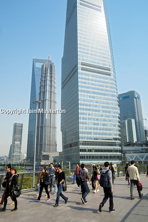 Busy pedestrian walkway surrounded by skyscrapers in Lujiazui financial district in Shanghai China