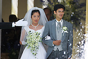 Bride and groom leaving the wedding chapel at an expensive hotel in Osaka, Japan.