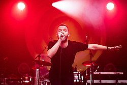 """© Licensed to London News Pictures . 07/07/2017 . Manchester , UK . Lead singer AARON STARKIE . """" The Slow Readers Club """" perform live at the Castlefield Bowl as part of Sounds of the City , during the Manchester International Festival . Photo credit : Joel Goodman/LNP"""
