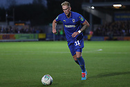 AFC Wimbledon midfielder Mitchell (Mitch) Pinnock (11) crossing the ball during the EFL Carabao Cup 2nd round match between AFC Wimbledon and West Ham United at the Cherry Red Records Stadium, Kingston, England on 28 August 2018.