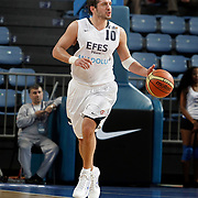 Efes Pilsen's Kerem TUNCERI during their Turkish Basketball Legague Play-Off qualifying second match Efes Pilsen between Pinar Karsiyaka at the Sinan Erdem Arena in Istanbul Turkey on Friday 13 May 2011. Photo by TURKPIX