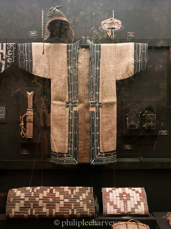 A display of traditional Ainu clothing at the Asahikawa Municipal Museum. The Ainu people are indigenous to Japan and Russia. Asahukawa, Hokkaid?, Japan