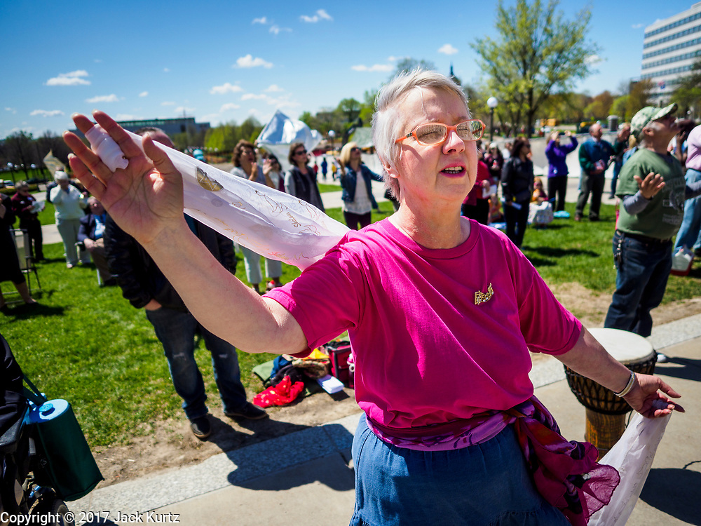 04 MAY 2017 - ST. PAUL, MN: A woman prays during a service at the Minnesota State Capitol. About 200 people gathered on the lawn in front of the Minnesota State Capitol in St. Paul for a noon time prayer service on the National Day of Prayer. Similar services were held across the country.     PHOTO BY JACK KURTZ