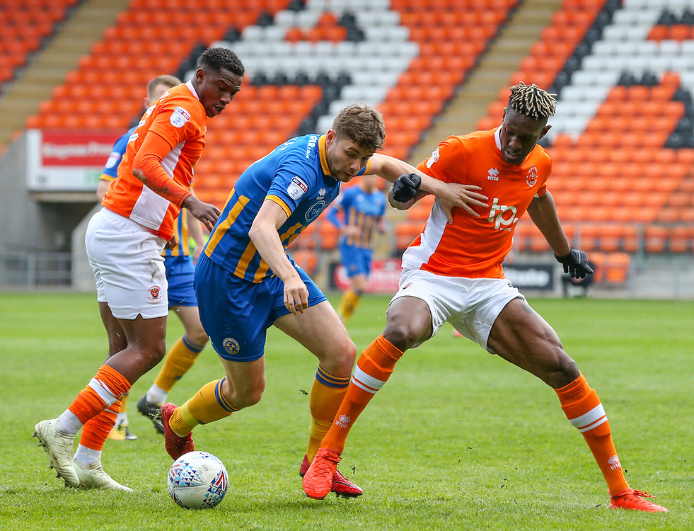 Blackpool's Armand Gnanduillet battles with Shrewsbury Town's Joe Riley<br /> <br /> Photographer Alex Dodd/CameraSport<br /> <br /> The EFL Sky Bet League One - Blackpool v Shrewsbury Town - Saturday 28th April 2018 - Bloomfield Road - Blackpool<br /> <br /> World Copyright © 2018 CameraSport. All rights reserved. 43 Linden Ave. Countesthorpe. Leicester. England. LE8 5PG - Tel: +44 (0) 116 277 4147 - admin@camerasport.com - www.camerasport.com