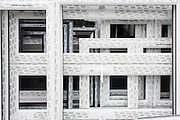 Detail of double-glazing window frames outside a glazier shop in a south London street.