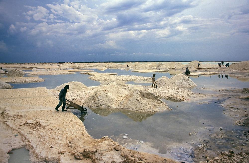 Salt miners shovel salt into piles, Manaure, La Guajira Peninsula