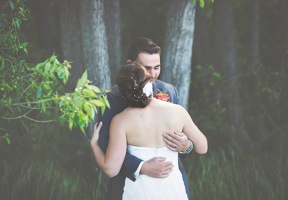 Wedding Photos by Connie Roberts Photography<br /> Bride and groom take a moment together after the ceremony