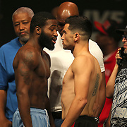 """Adrien Broner (left) and Carlos Molina stare each other down during the official weigh-ins for the Mayweather versus Maidana boxing match slated as """"The Moment"""", at the MGM Grand hotel on Friday, May 2, 2014 in Las Vegas, Nevada.  (AP Photo/Alex Menendez)"""