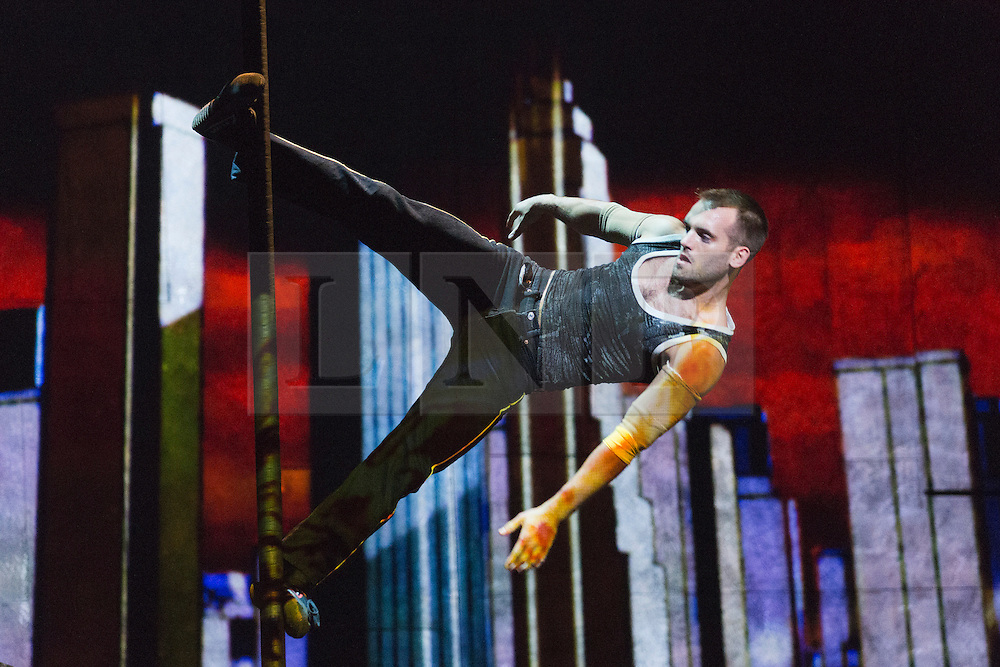 """© Licensed to London News Pictures. 30/09/2013. London, England. Pictured: Conor Neall on the Chinese Pole. The 15 performers from the Canadian troupe Cirque Éloize perform their show """"iD"""" at London's Peacock Theatre from 1 to 19 October 2013. """"iD"""" is a blend of circus arts and urban dance. Photo credit: Bettina Strenske/LNP"""