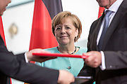 German Chancellor Angela Merkel watches as German and Chinese counterparts exchange mutual agreement,  prior to a Joint press conference in the Chancellery in Berlin, on July 5 2017.<br /> (Photo by Omer Messinger)