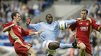 Photo: Aidan Ellis.<br /> Manchester City v Portsmouth. The Barclays Premiership.<br /> 27/08/2005.<br /> Manchester's Andrew Cole looks to control the ball in between Pompy's Andrew O' Brien and Matt Taylor