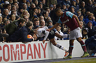 Dele Alli of Tottenham Hotspur finds himself in with the supporters as he falls over the advertising hoarding after being pushed by Winston Reid of West Ham United (r). Barclays Premier league match, Tottenham Hotspur v West Ham Utd at White Hart Lane in London on Sunday 22nd November 2015.<br /> pic by John Patrick Fletcher, Andrew Orchard sports photography.