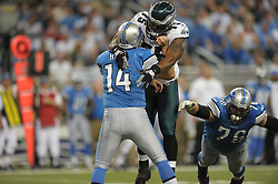 DETROIT - SEPTEMBER 19: Defensive end Juqua Parker #75 of the Philadelphia Eagles hits quarterback Shaun Hill #14 of the Detroit Lions on September 19, 2010 at Ford Field in Detroit, Michigan. The Eagles won 35-32. (Photo by Drew Hallowell/Getty Images)  *** Local Caption *** Juqua Parker;Shaun Hill