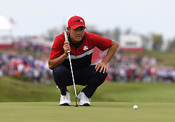 Team USA's Collin Morikawa lines up a shot on the 16th green during day three of the 43rd Ryder Cup at Whistling Straits, Wisconsin. Picture date: Sunday September 26, 2021.