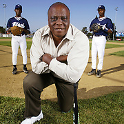 John Young, founder of RBI, an inner city baseball revitalization organization that promotes baseball to inner city youths and renovates baseball fields. Photographed at the field at Algin Sutton Recreation Center in Los Angeles, CA with some of the players playing in the RBI league.